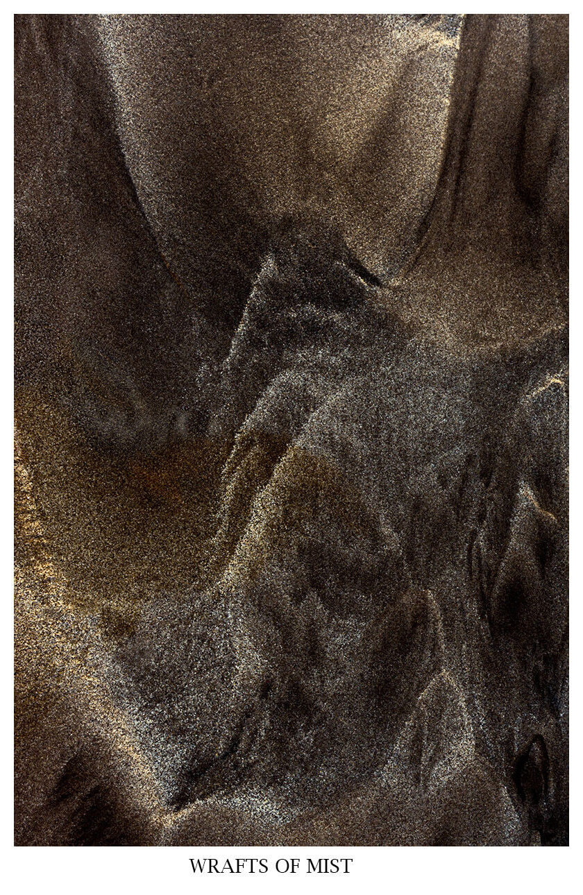 WRAFTS OF MIST is an abstract close-up photography of a mixture of vulcanic black ash and white beach sand.